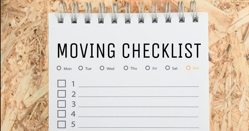 Moving Checklist Notebook on top of Wooden moving crate
