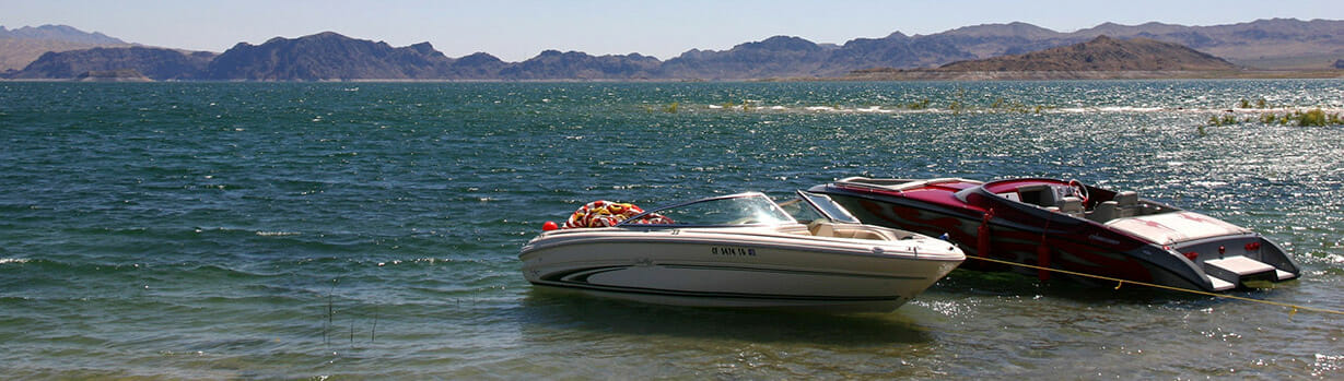 Photo of Lake Meade with boats and mountains in the background