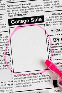moving sale advertisement in classified section of the newspaper